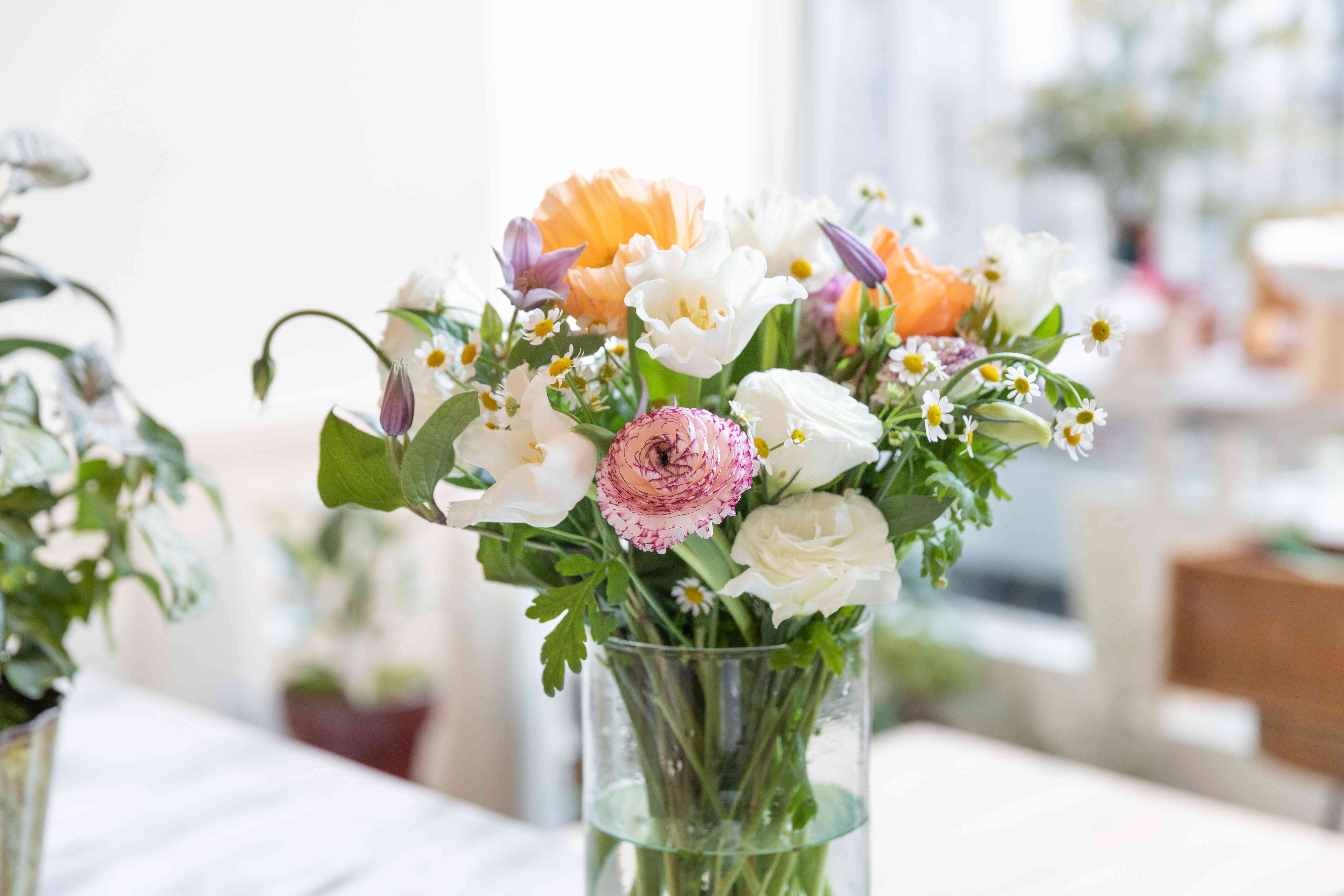 Bouquet of assorted flowers placed in vase of water