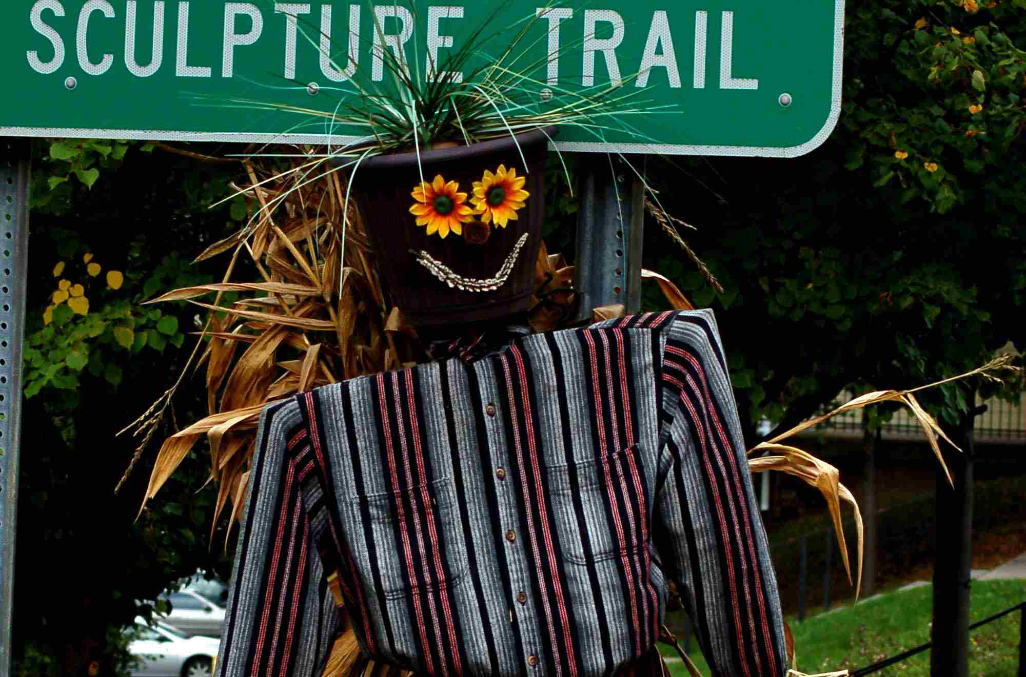 Scarecrow with a head functioning as a planter