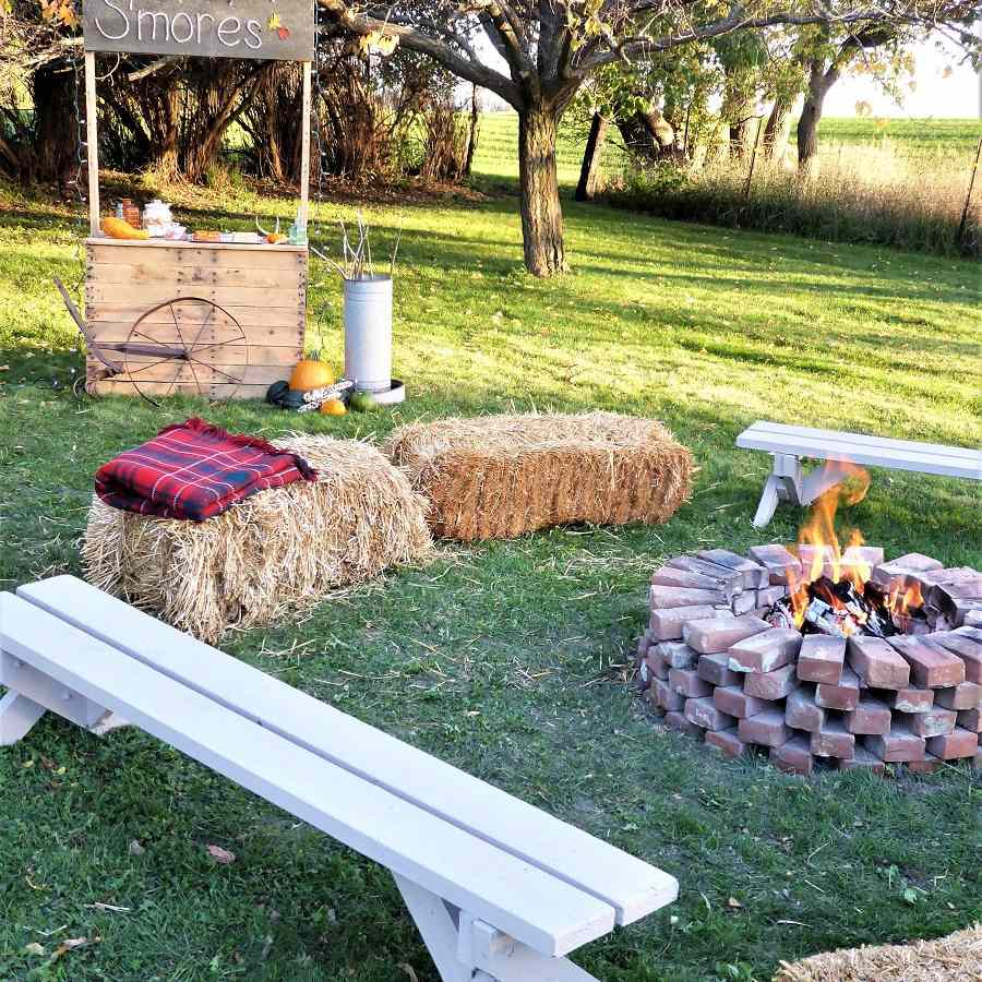 Outdoor bonfire with hay benches