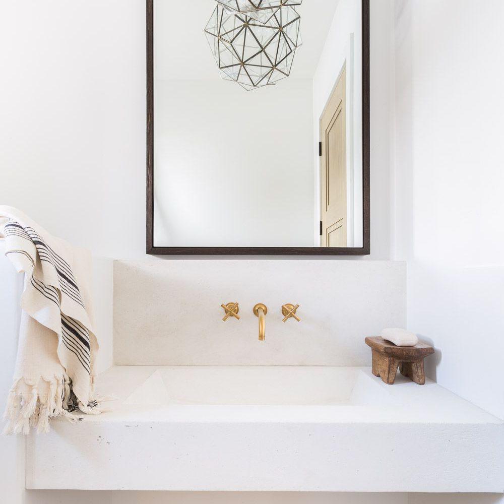 hexagon chandelier over bathroom room vanity
