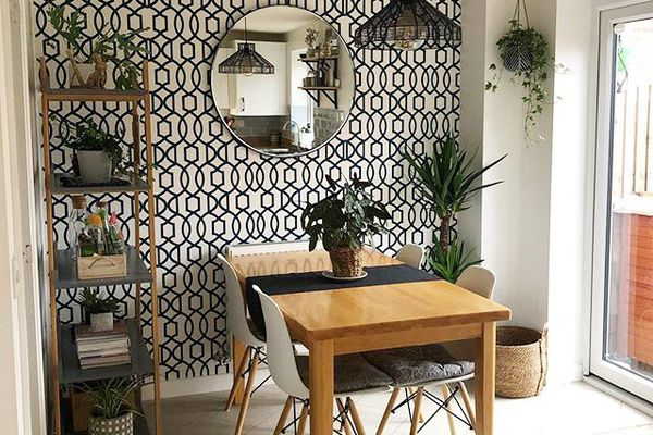 Small dining room with black and white wallpaper