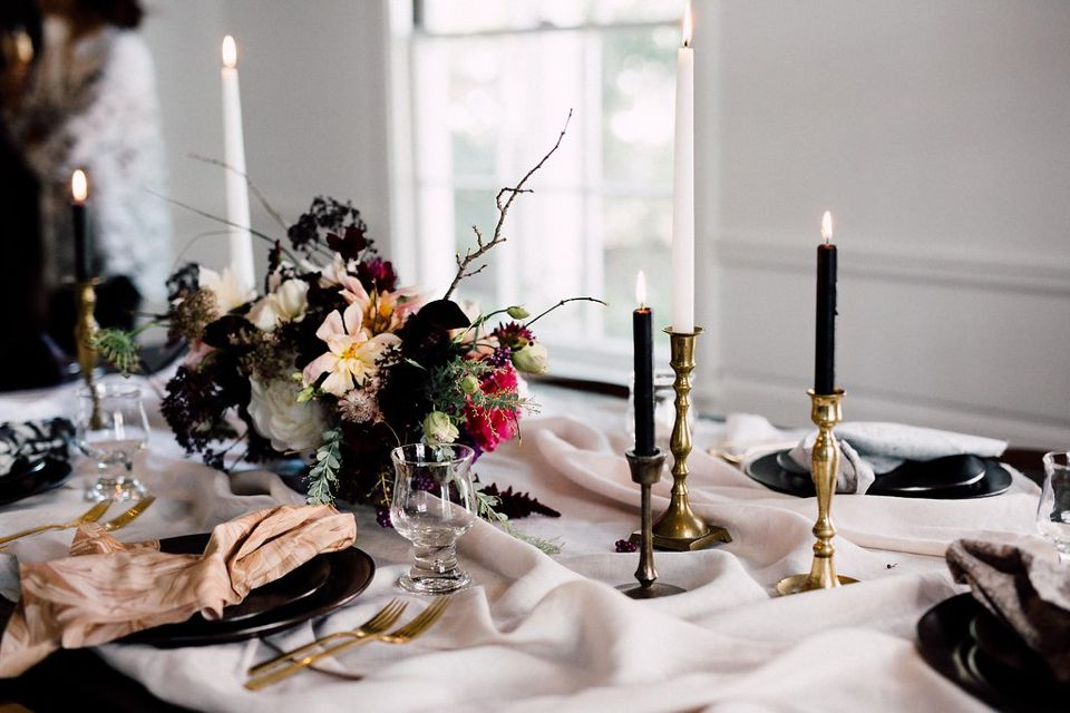 Dark moody floral holiday table.