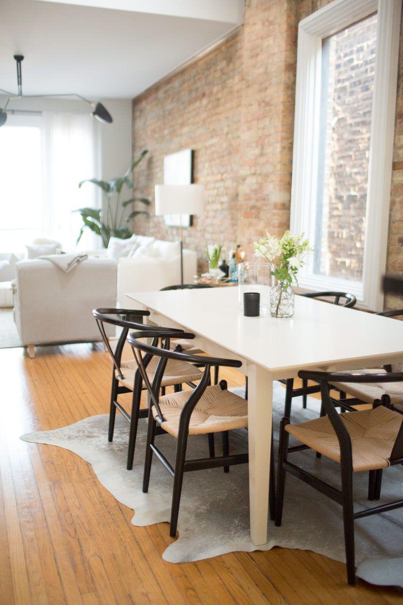exposed brick dining room wishbone chairs