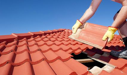 A man laying clay roof tile