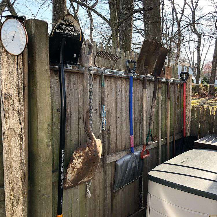 Tools hanging on fence