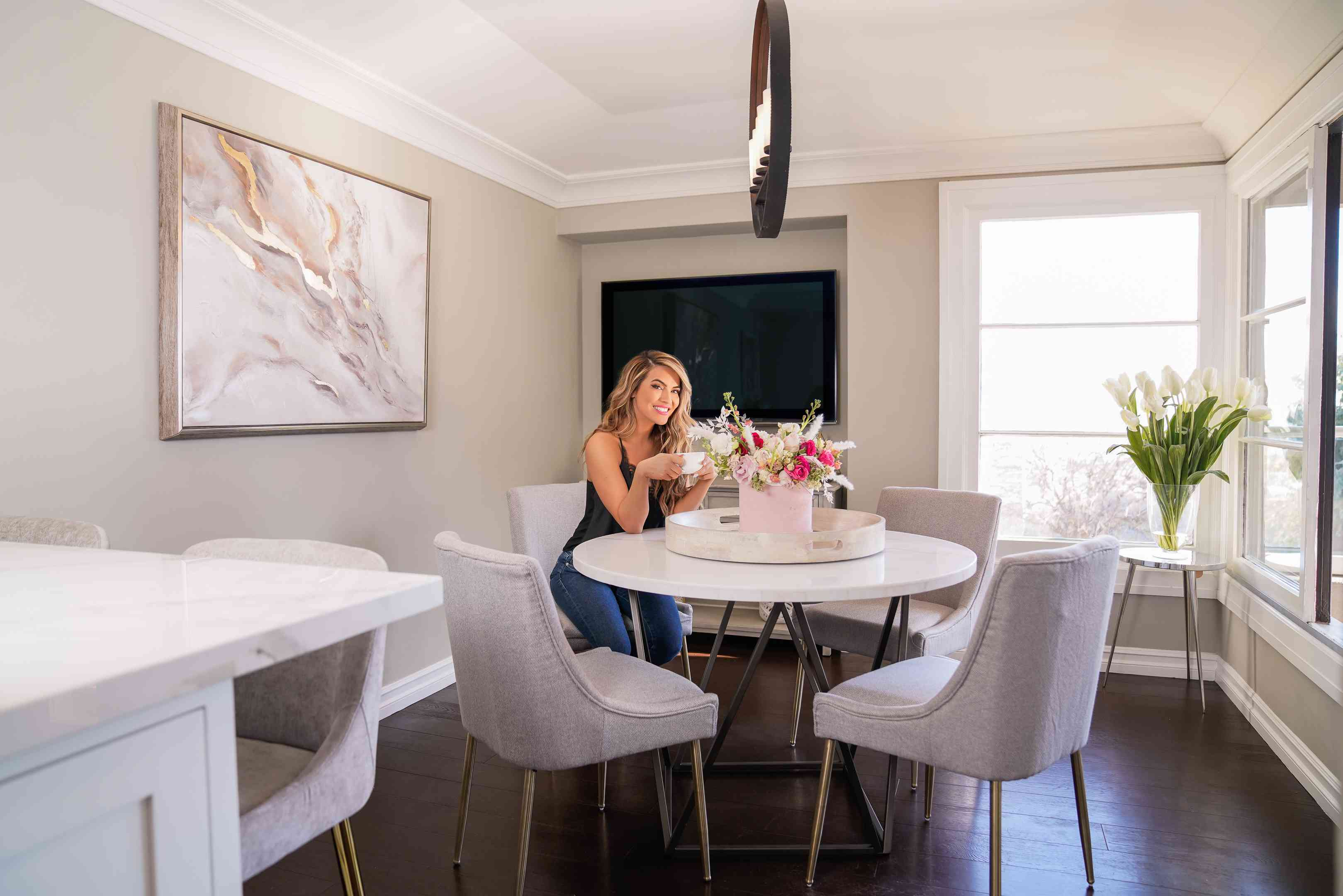 Chrishell Stause poses in her new kitchen nook after redecorating with items from TJMaxx and Marshalls
