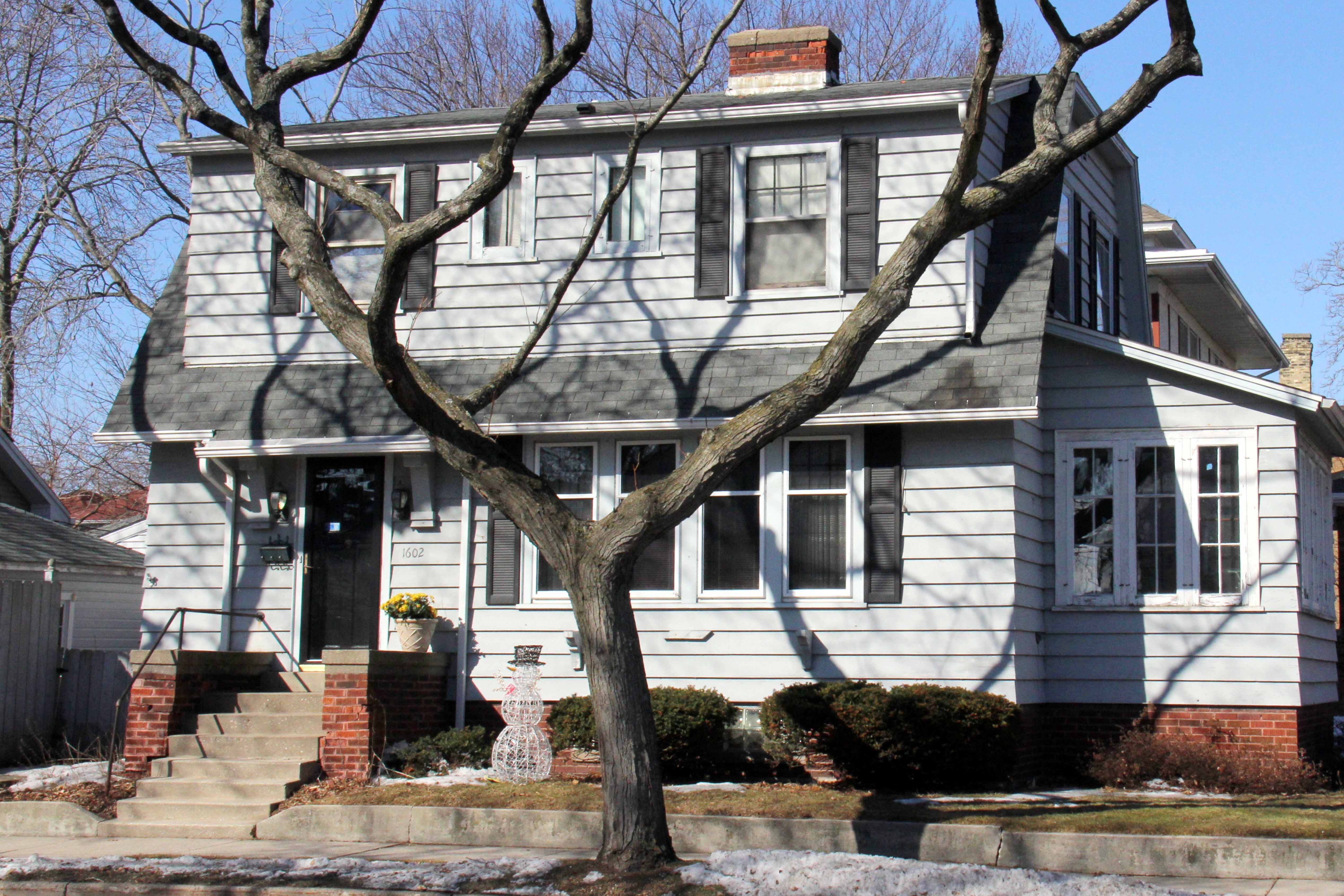 Typical American home with four-window dormer along the length of the roof facade