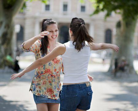 Proper casual greeting etiquette young women hugging m4hsunfo