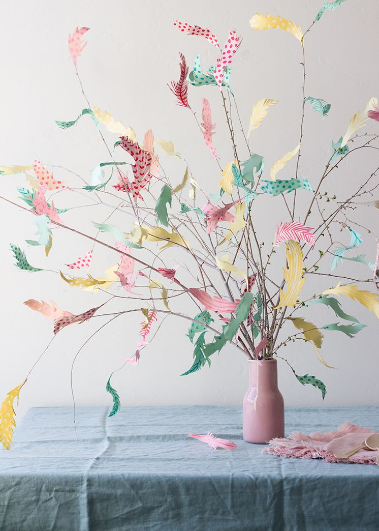 Branches with paper feathers in a vase