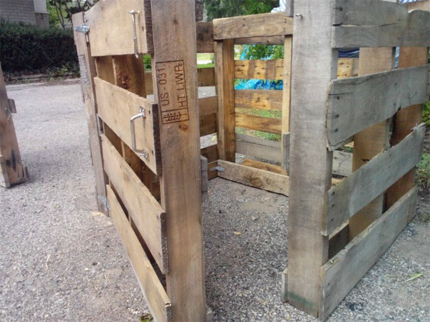 A compost bin built out of pallets