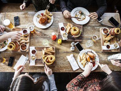 Friends eating pub burgers