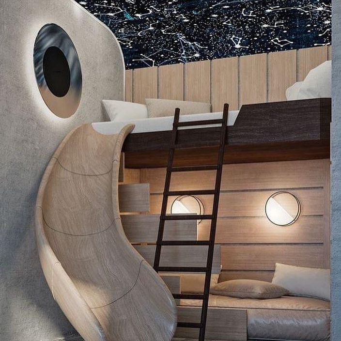A celestial style loft with two beds and a wood slide.