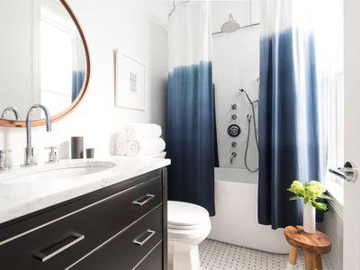 small shower with tiny tub indigo bathroom