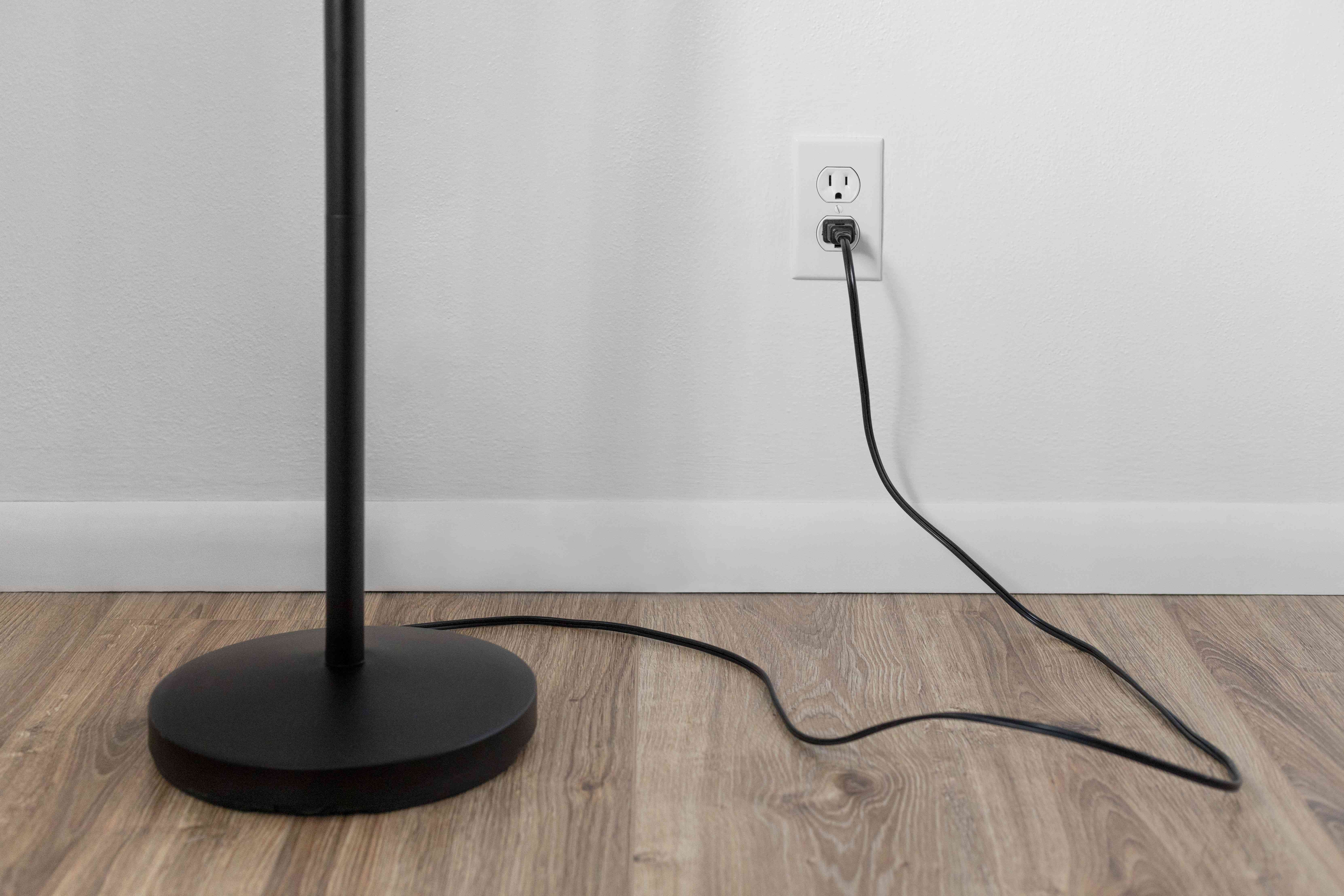 Floor lamp plugged into wall outlet
