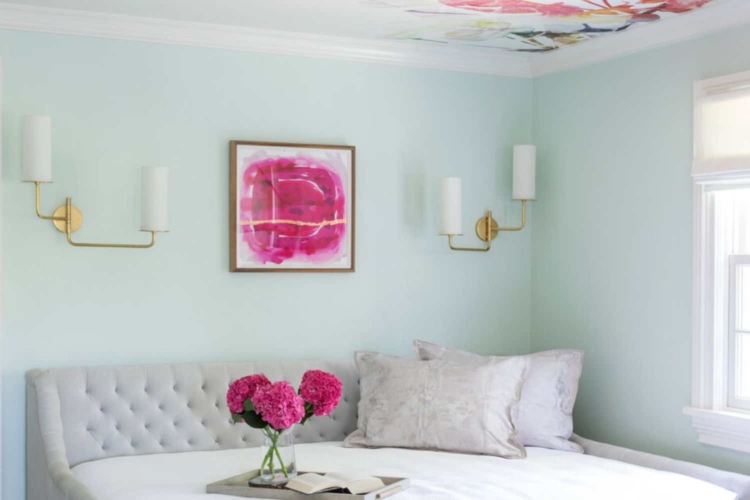 bedroom with pale blue walls and hot pink accents, with pink flower mural on the ceiling
