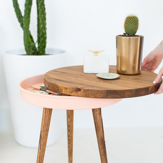 A sliding end table with a plant on it