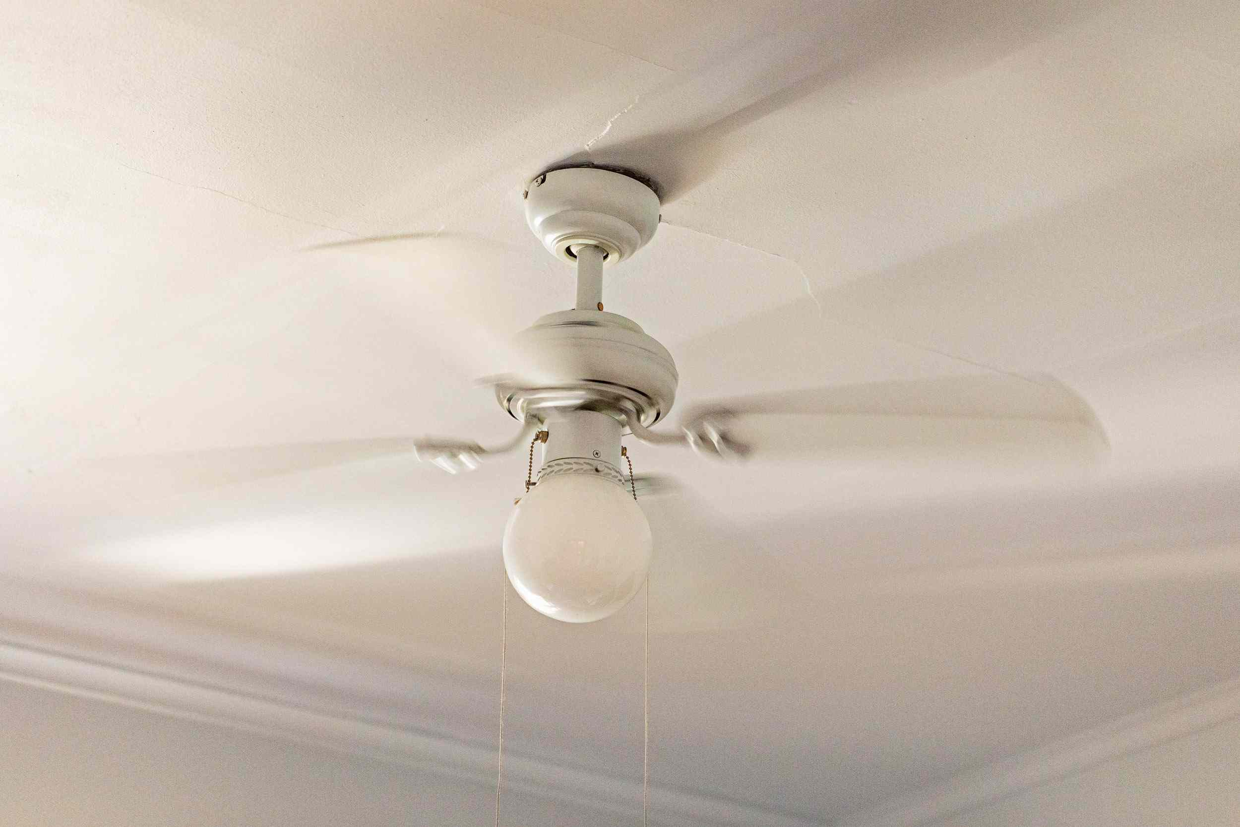 a ceiling fan that's turned on