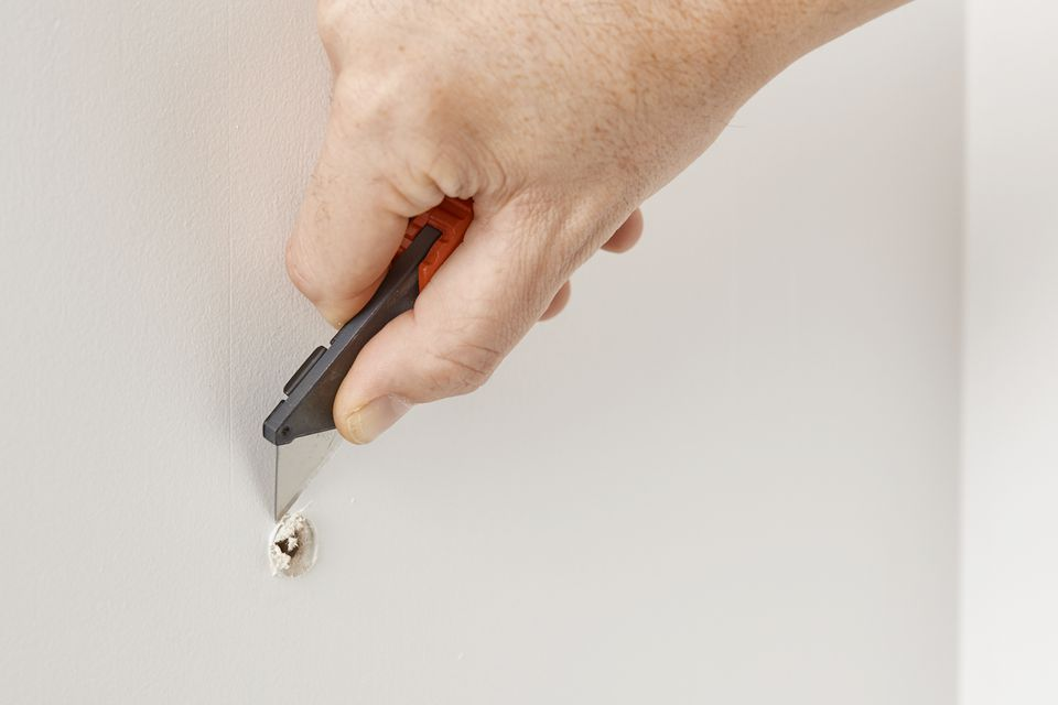repairing a small hole in drywall