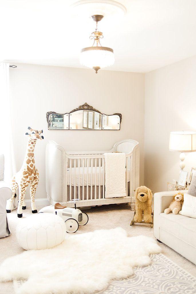 Elegant, all-white nursery room