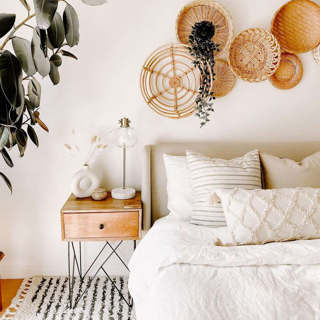 Bedroom with baskets hanging over the bed