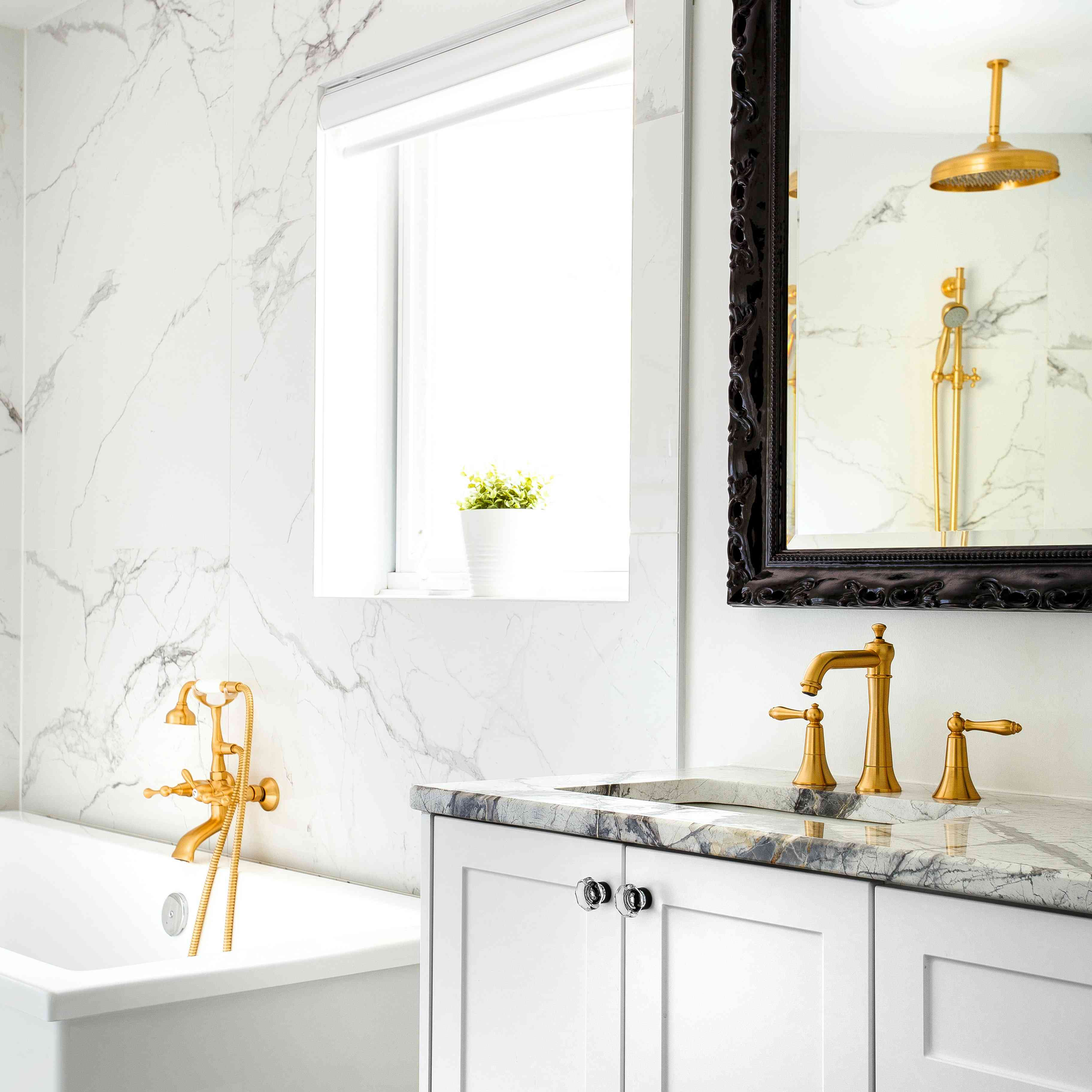 modern white bathroom with marble and gold accents