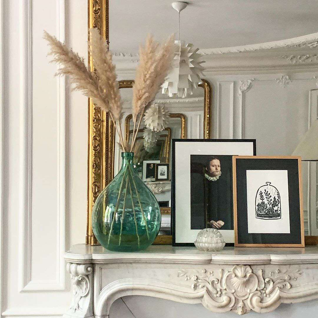 Mantle with gold mirror on top
