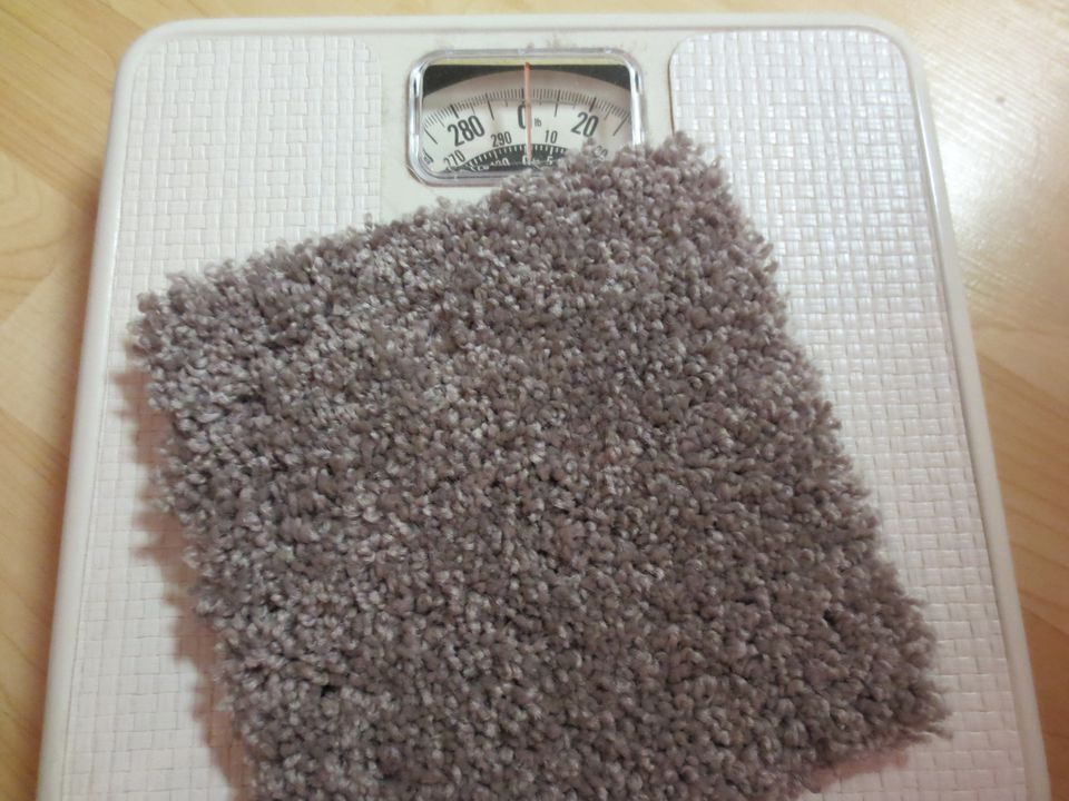 Carpet tile weighed on a scale