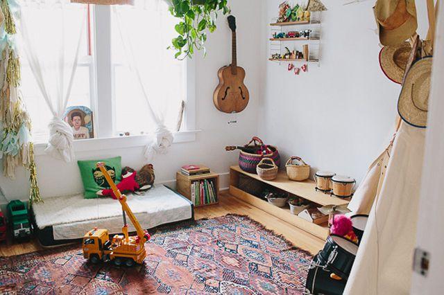 Modern bohemian nursery with floor bed