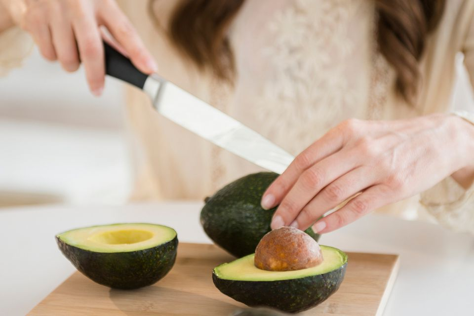 A woman cutting avocado