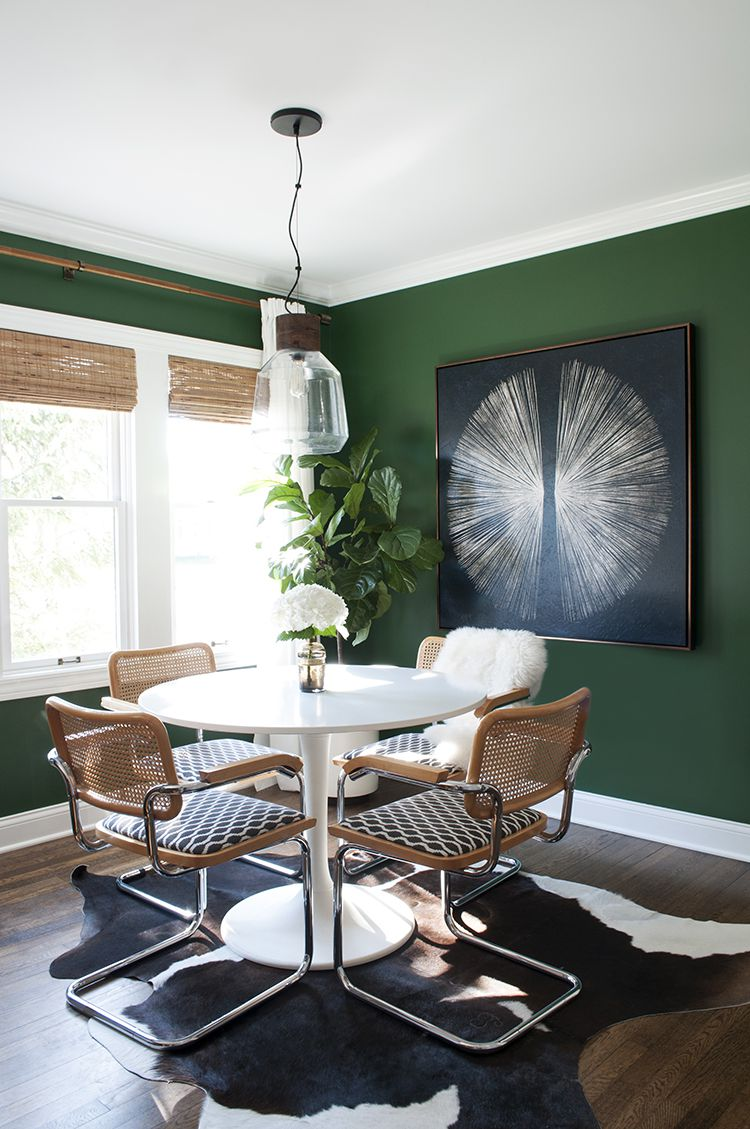 green dining room with natural touches