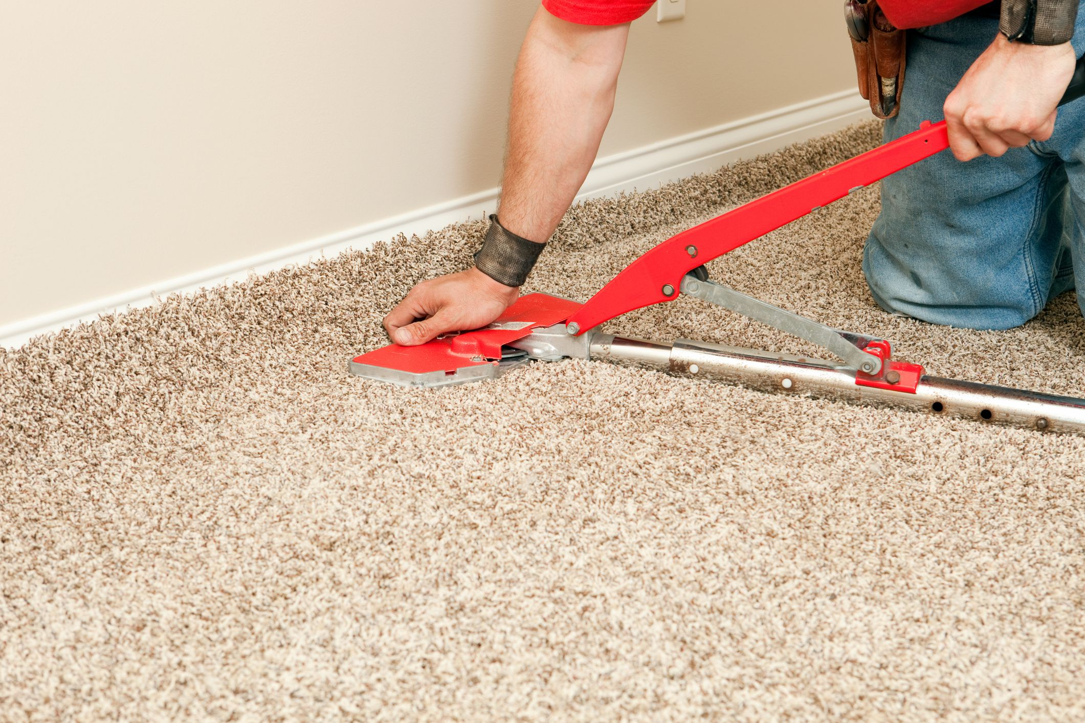 Using A Power Stretcher When Installing Carpet