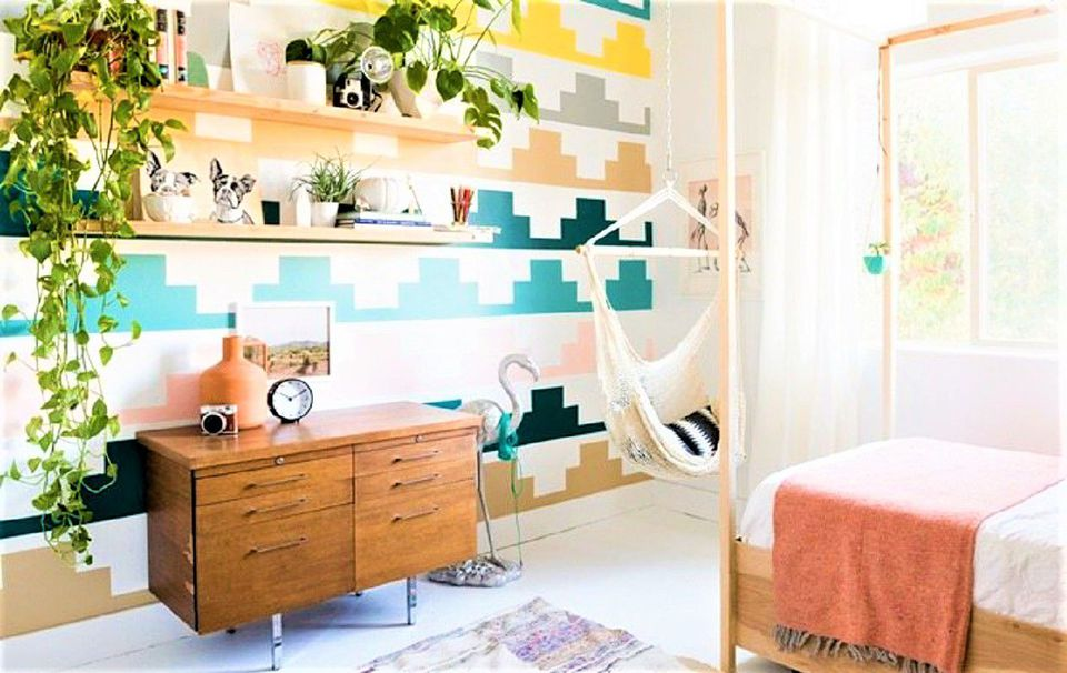 Bedroom with houseplants, dresser, reading hammock, and bed.