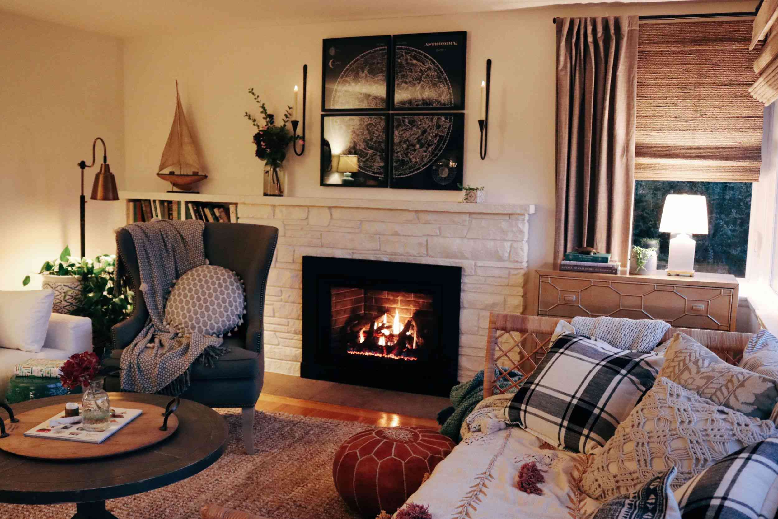 den with fireplace and layered blankets