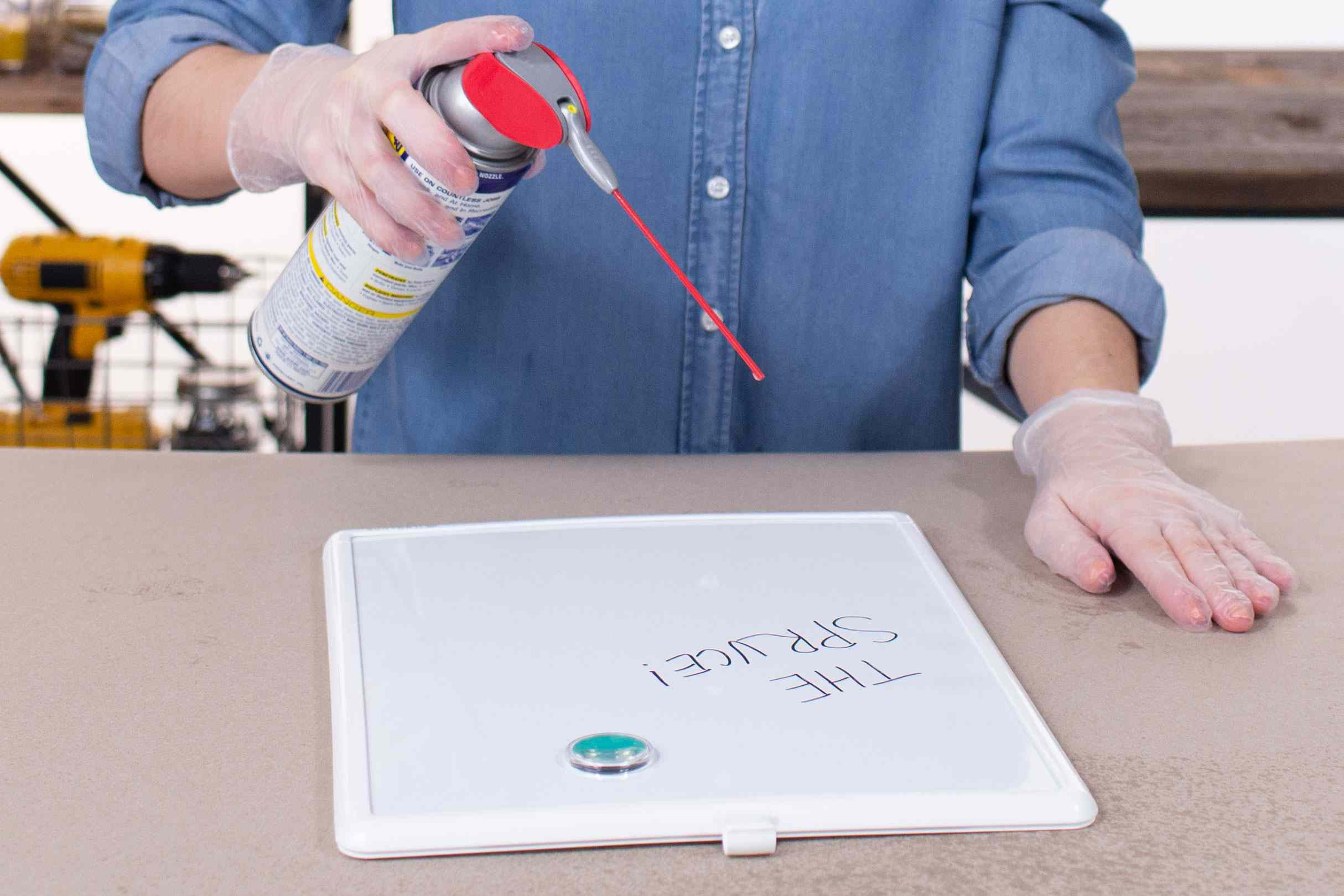 Spraying white board with WD-40