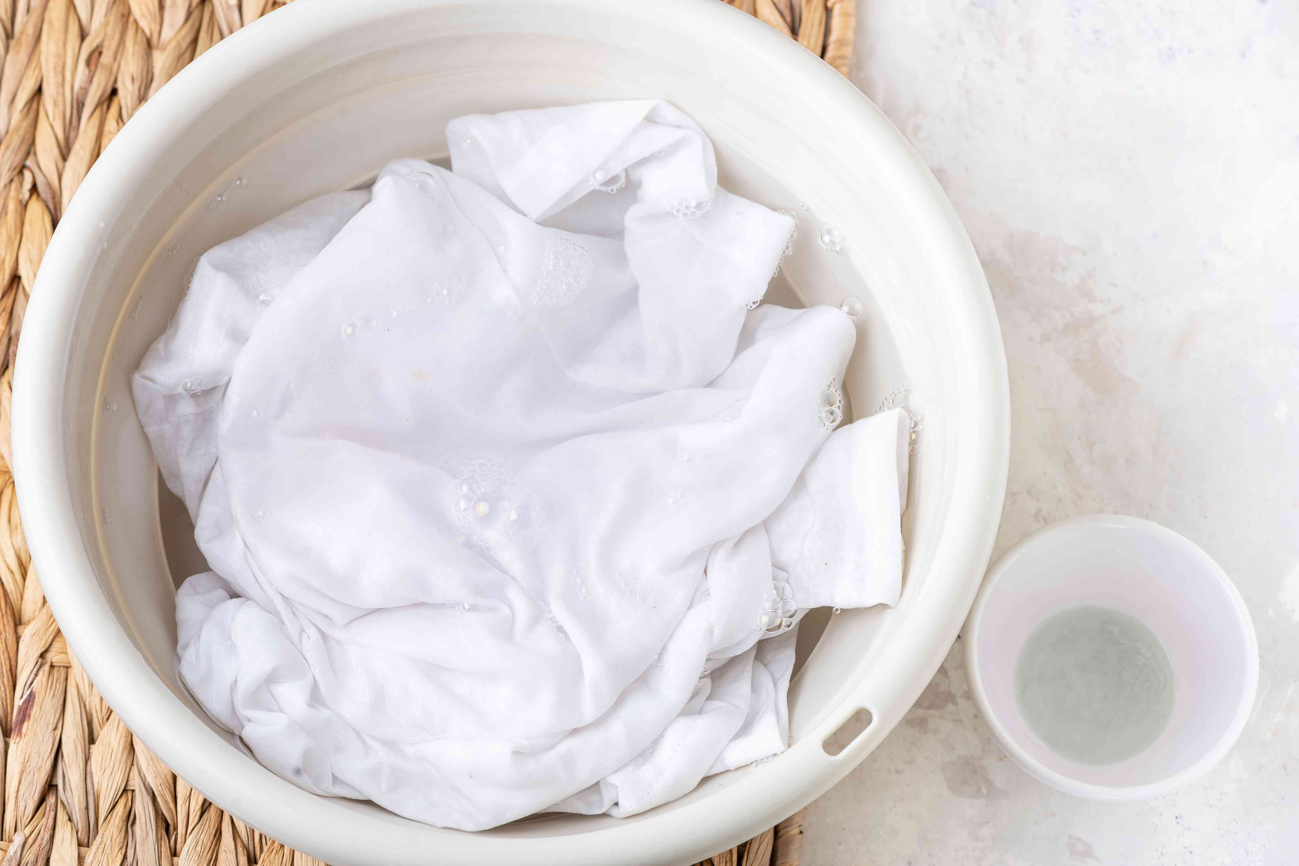 soaking the garment in an oxygen bleach solution