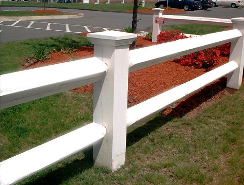 Picture of a post and rail fence.