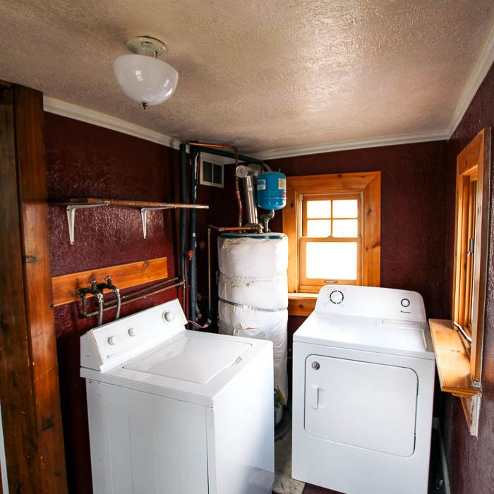 Dark laundry room before.