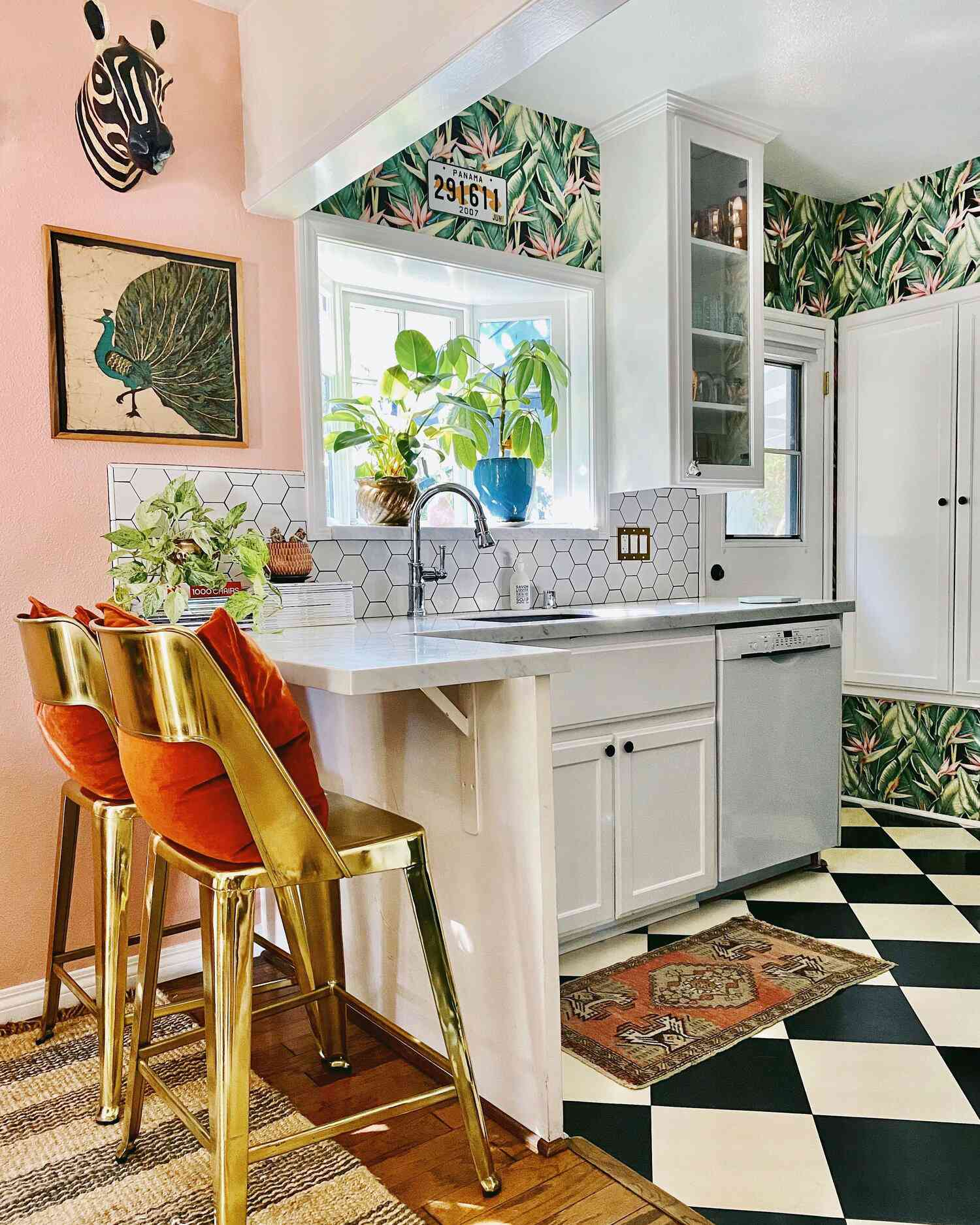 Pink kitchen with palm wallpaper