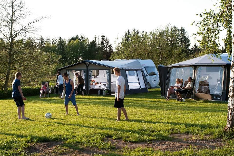 Kids playing games on camping trip.
