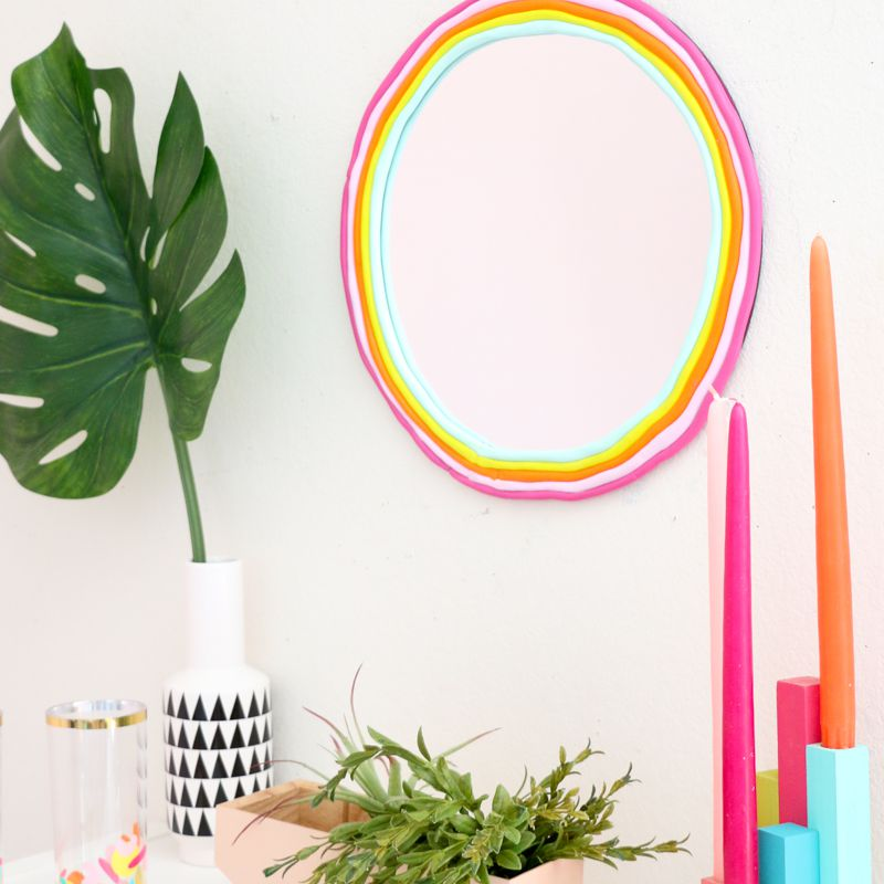 A DIY round rainbow mirror made using clay