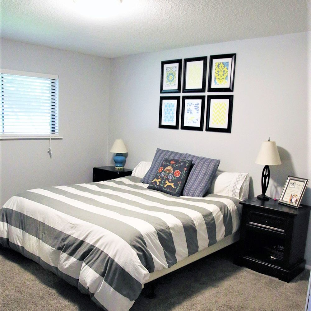 Gray bedroom with gray blanket and two nightstands