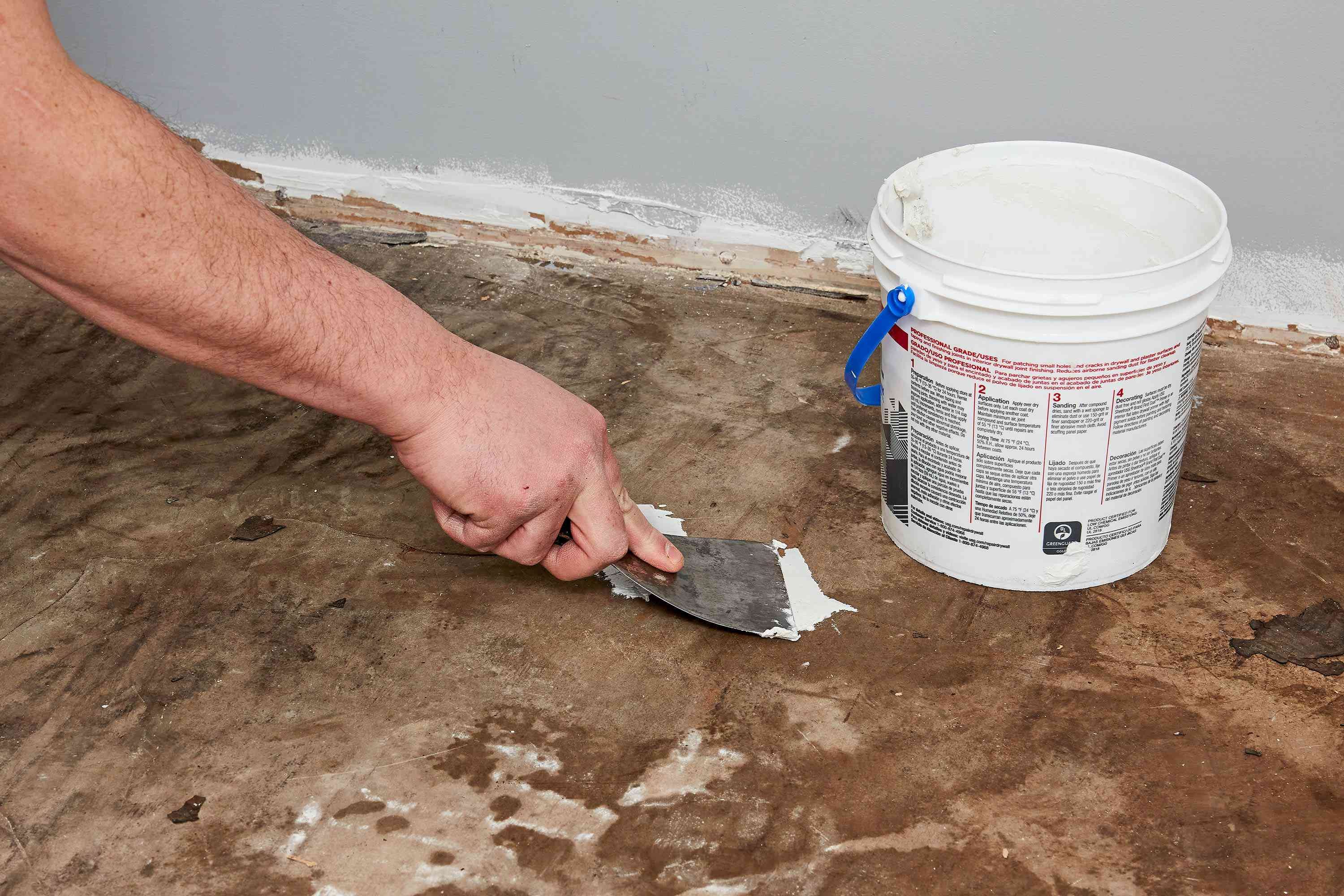 Subfloor cracks filled with concrete patcher