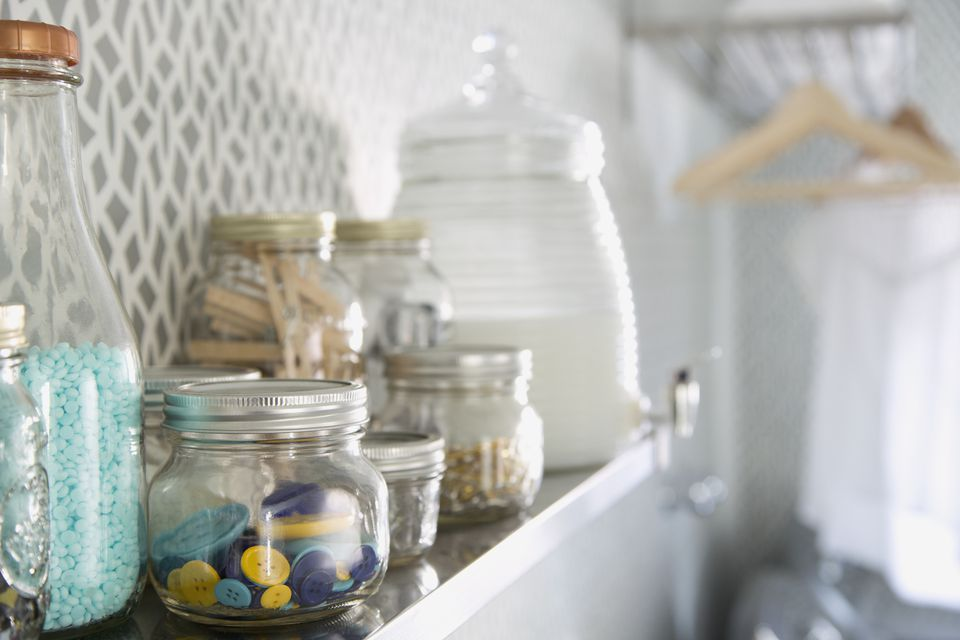 Organizing jars in laundry room
