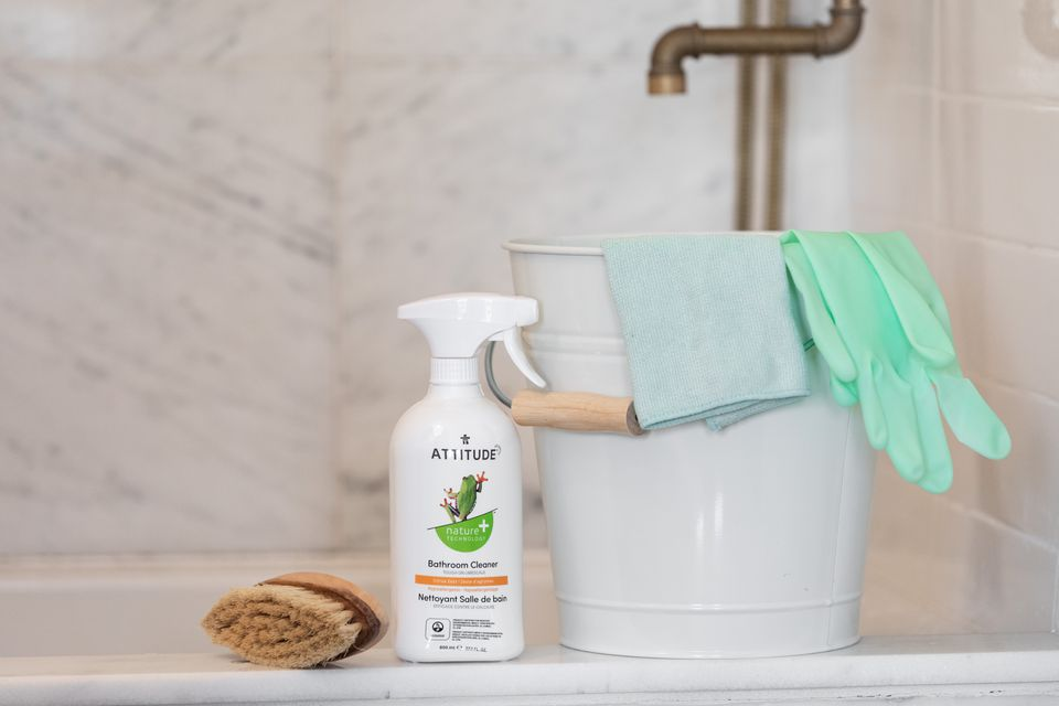 Eco-friendly cleaning bottle with cleaning supplies in bathroom