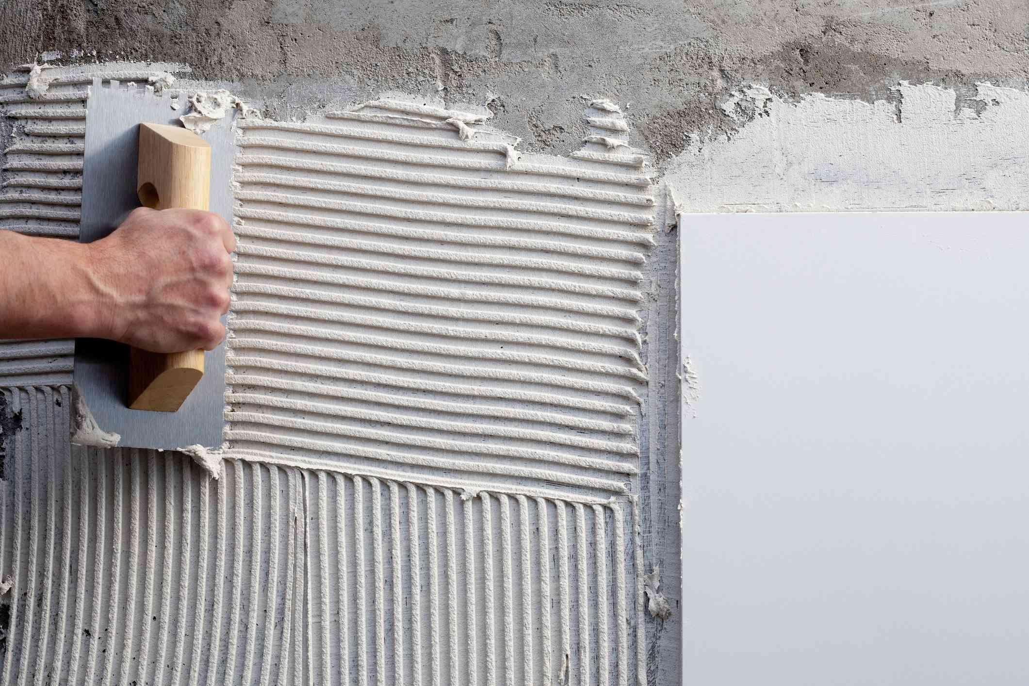 Construction worker using trowel