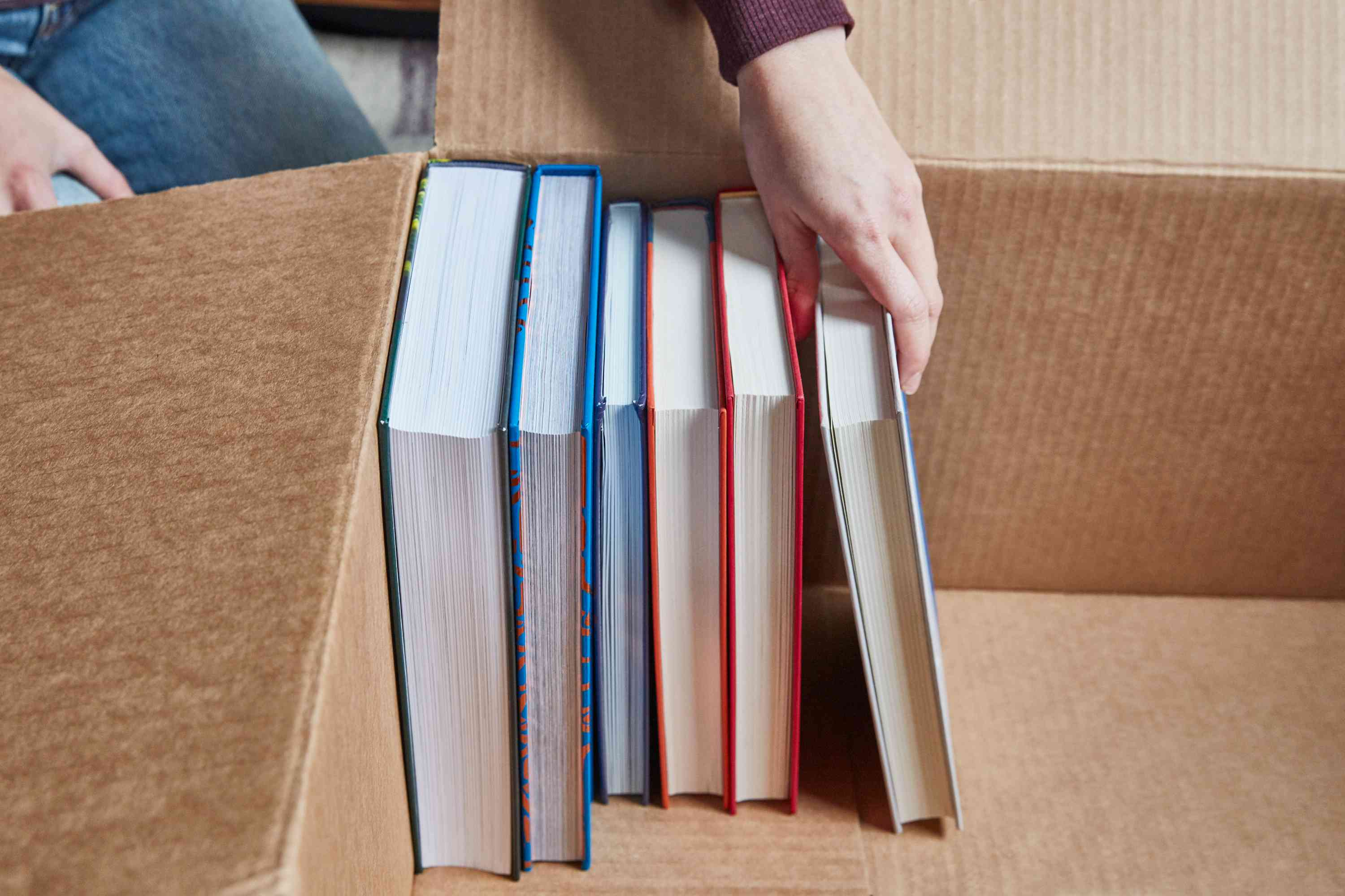 the proper way to pack hardcover books