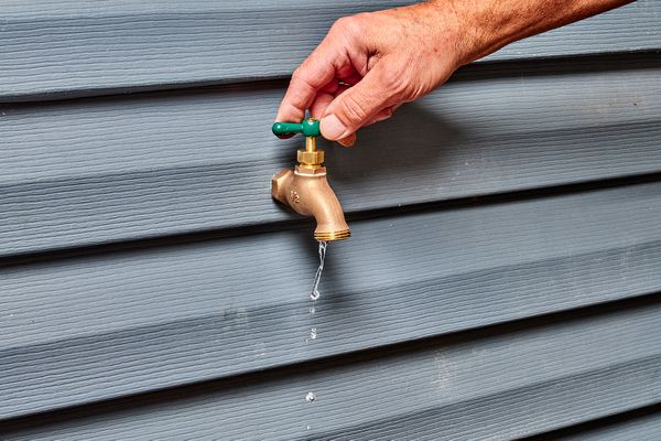 Hose bib leaking water on exterior wall
