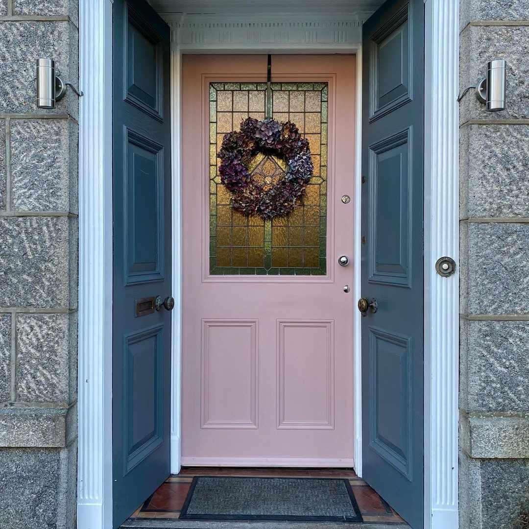 Pink door with wreath