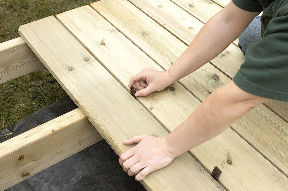 Laying decking, spacing boards 5mm apart, close-up
