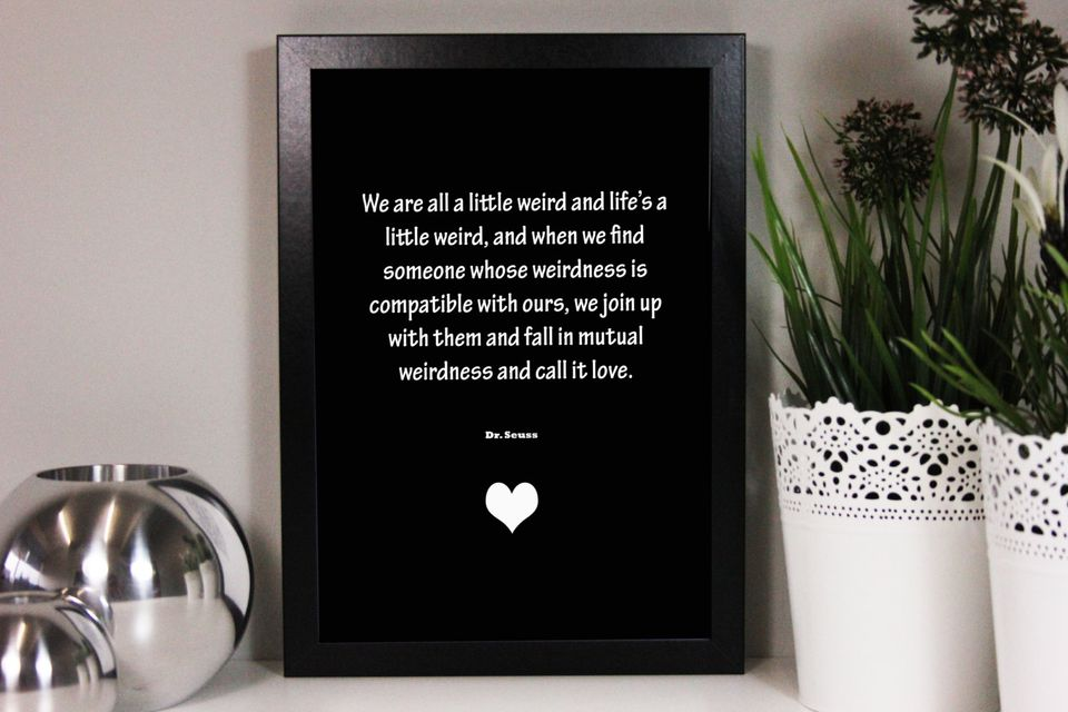 Black picture frame with a Dr. Seuss wedding quote.